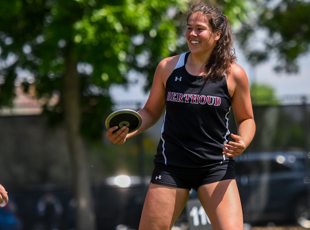 . Berthoud\'s Kailey Berry smiles after a final-qualifying toss during the discus competition at the 2018 state track and field meet Friday May 18, 2018 at Jeffco Stadium in Lakewood. (Cris Tiller / Loveland Reporter-Herald)