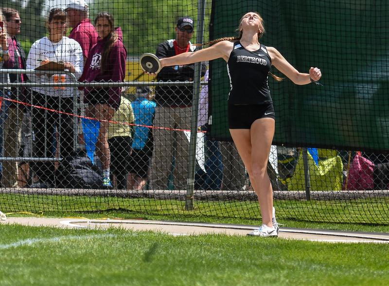 Berthoud's Emily Cavey tosses her discus at the 2018 state track and field meet Friday May 18, 2018 at Jeffco Stadium in Lakewood. (Cris Tiller / Loveland Reporter-Herald)