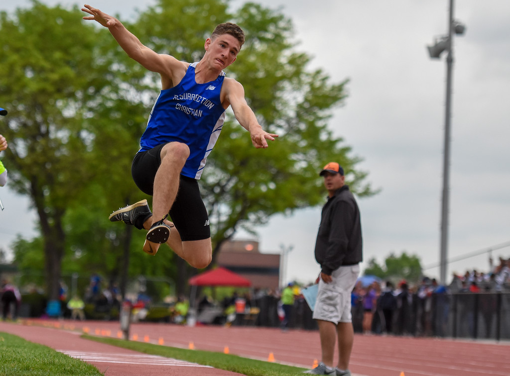 . Resurrection Christian\'s Ryan Applebee leaps during the 2A triple jump at the 2018 state track and field meet Friday May 18, 2018 at Jeffco Stadium in Lakewood. (Cris Tiller / Loveland Reporter-Herald)