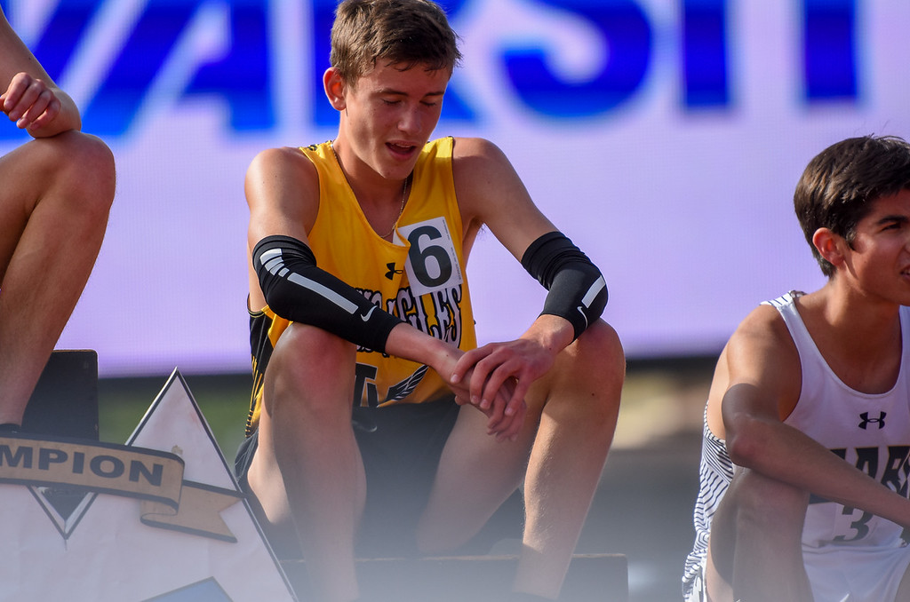 . Thompson Valley\'s Dylan Schubert takes a moment to catch his breath on the podium after placing third in the 4A 3,200-meter run at the 2018 state track and field meet Friday May 18, 2018 at Jeffco Stadium in Lakewood. (Cris Tiller / Loveland Reporter-Herald)