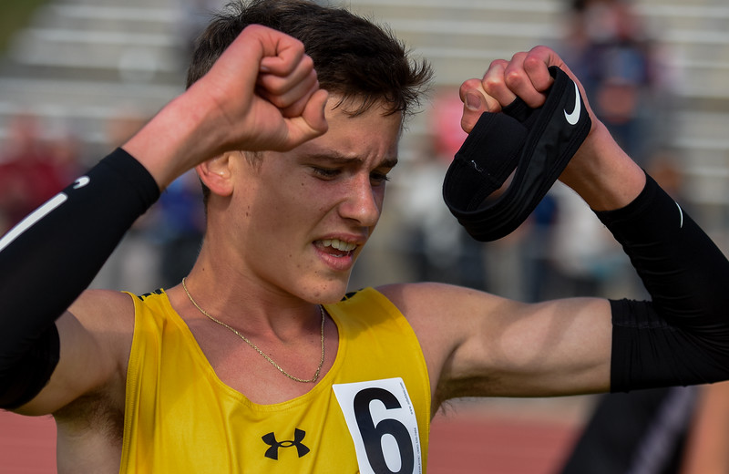 Thompson Valley's Dylan Schubert raises his arms in achievement after placing third in the 4A 3,200-meter run at the 2018 state track and field meet Friday May 18, 2018 at Jeffco Stadium in Lakewood. (Cris Tiller / Loveland Reporter-Herald)