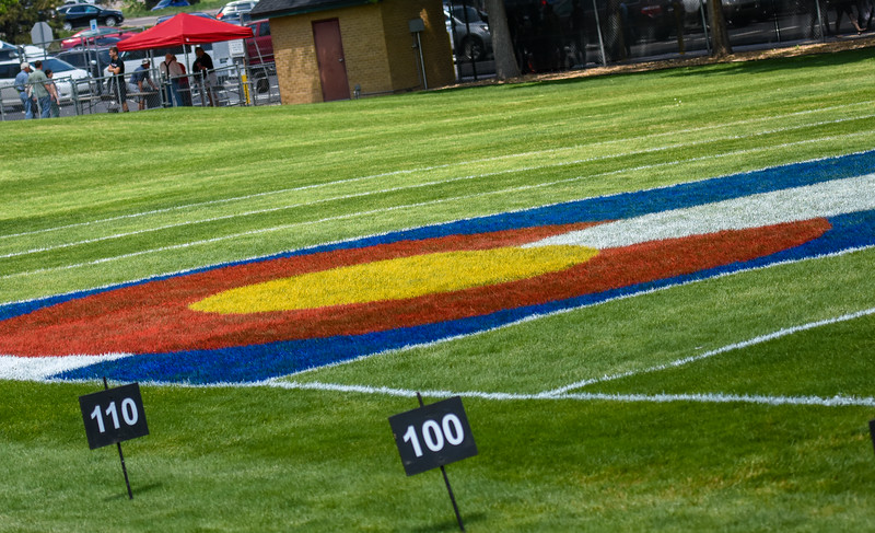 A Colorado state flag is painted on the discus field at the 2018 state track and field meet Friday May 18, 2018 at Jeffco Stadium in Lakewood. (Cris Tiller / Loveland Reporter-Herald)