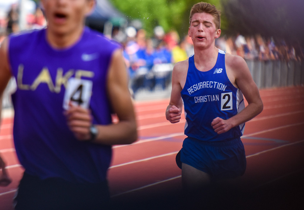 . Resurrection Christian\'s Christian Fagerlin grits through his 3,200-meter run at the 2018 state track and field meet Friday May 18, 2018 at Jeffco Stadium in Lakewood. (Cris Tiller / Loveland Reporter-Herald)