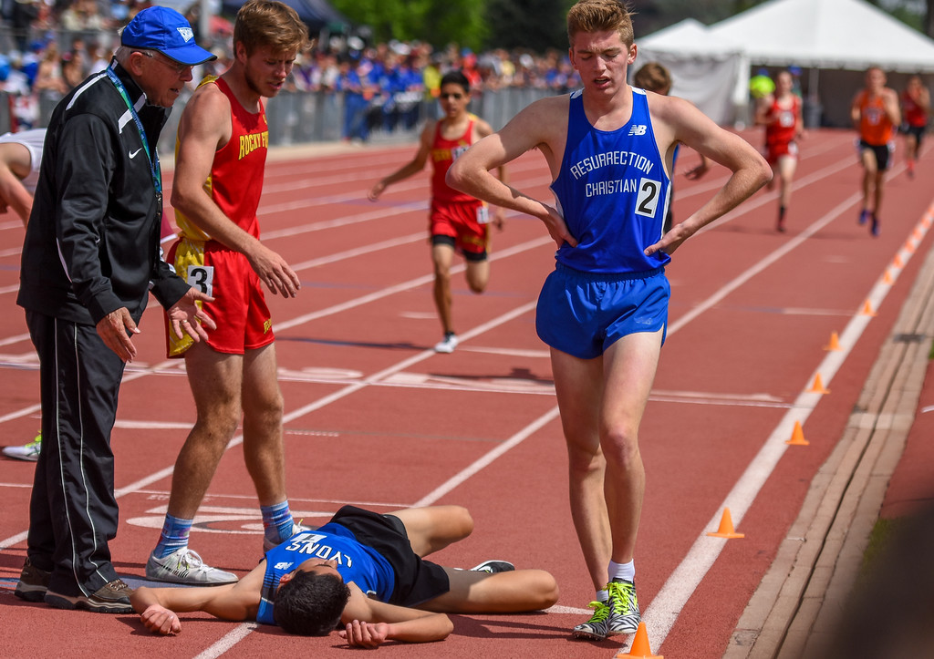 . Resurrection Christian\'s Christian Fagerlin takes heavy breaths at the end of the 2A 3,200-meter run at the 2018 state track and field meet Friday May 18, 2018 at Jeffco Stadium in Lakewood. (Cris Tiller / Loveland Reporter-Herald)