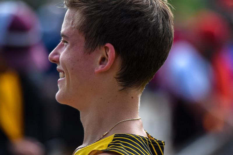 Thompson Valley's Dylan Schubert smiles to his team after placing third in the 4A 3,200-meter run at the 2018 state track and field meet Friday May 18, 2018 at Jeffco Stadium in Lakewood. (Cris Tiller / Loveland Reporter-Herald)