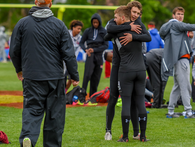 Berthoud's Ryan Schmad is hugged by teammate Jake Rafferty after winning the 3A 4x100-meter relay state championship at the 2018 state track and field meet Saturday May 19, 2018 at Jeffco Stadium in Lakewood. (Cris Tiller / Loveland Reporter-Herald)
