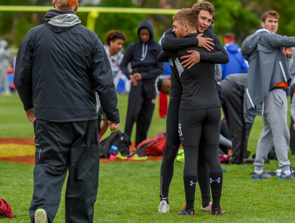 . Berthoud\'s Ryan Schmad is hugged by teammate Jake Rafferty after winning the 3A 4x100-meter relay state championship at the 2018 state track and field meet Saturday May 19, 2018 at Jeffco Stadium in Lakewood. (Cris Tiller / Loveland Reporter-Herald)