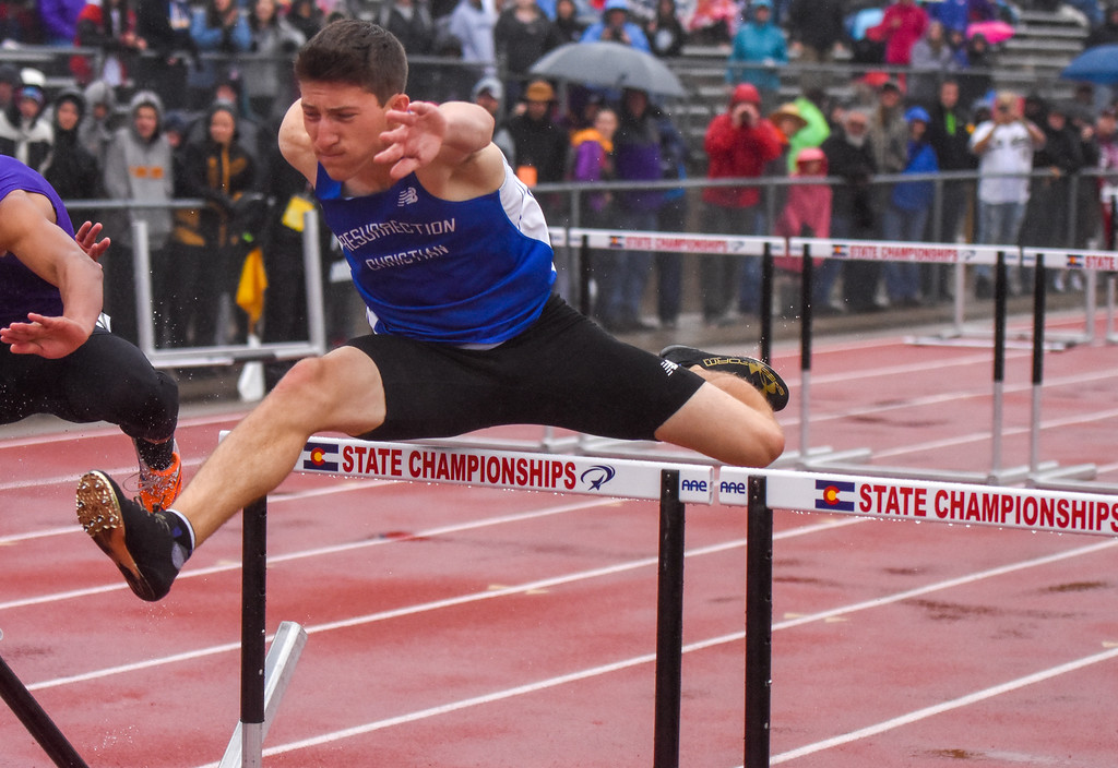 . Resurrection Christian\'s Ben Jackson clears a hurdle during the 2A 110-meter hurdles at the 2018 state track and field meet Saturday May 19, 2018 at Jeffco Stadium in Lakewood. (Cris Tiller / Loveland Reporter-Herald)