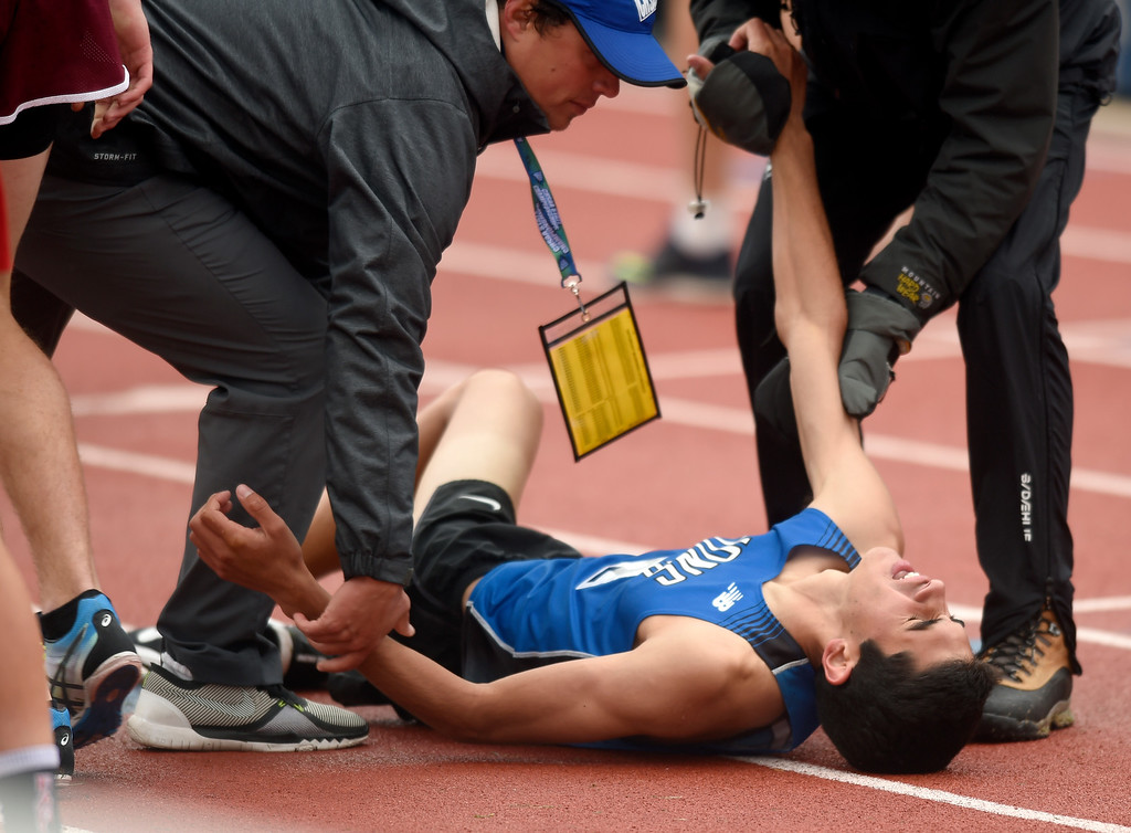 . Lyons High School\'s Isaac Roberts collapses after finishing third in the 2A boys 1600-meter finals during the CHSAA State Track and Field Championships on Saturday at the Jeffco Stadium in Lakewood. For more photos of the races go to dailycamera.com Jeremy Papasso/ Staff Photographer 05/19/2018