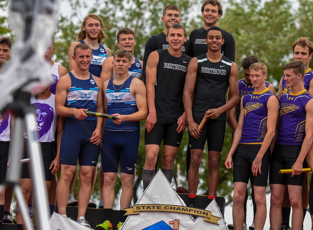 . Berthoud\'s Jake Rafferty, back left, Ryan Schmad, back right, Connor Siruta, front left, and Trinity Buckley takes the podium after winning the 3A 4x100-meter relay state championship at the 2018 state track and field meet Saturday May 19, 2018 at Jeffco Stadium in Lakewood. (Cris Tiller / Loveland Reporter-Herald)