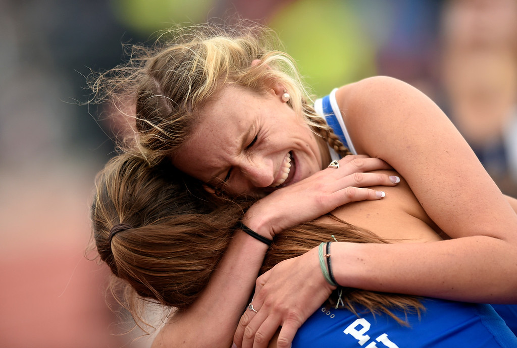 . Peak to Peak Charter School\'s Quinn MConnell hugs a teammate after finishing fourth in the 3A 1600-meter final during the CHSAA State Track and Field Championships on Saturday at the Jeffco Stadium in Lakewood. McConnell finished fourth. For more photos of the races go to dailycamera.com Jeremy Papasso/ Staff Photographer 05/19/2018