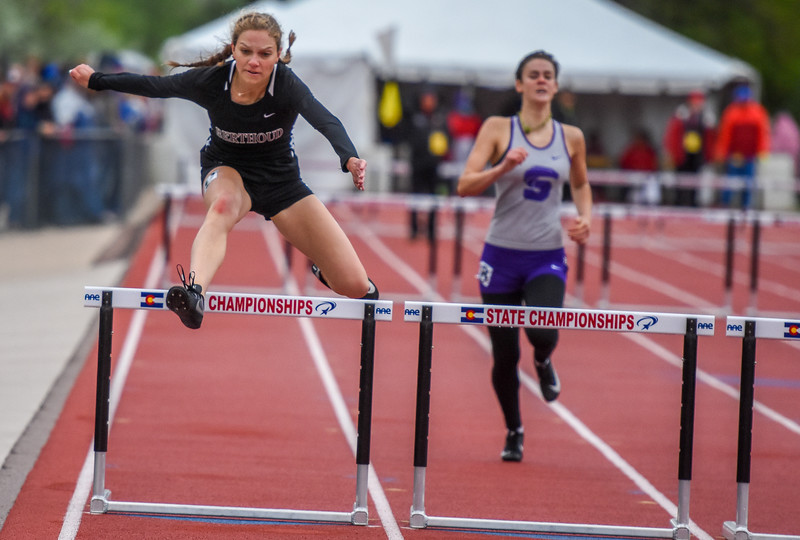 Berthoud's Samantha Mulder leaps during the 3A 300-meter hurdles at the 2018 state track and field meet Saturday May 19, 2018 at Jeffco Stadium in Lakewood. (Cris Tiller / Loveland Reporter-Herald)