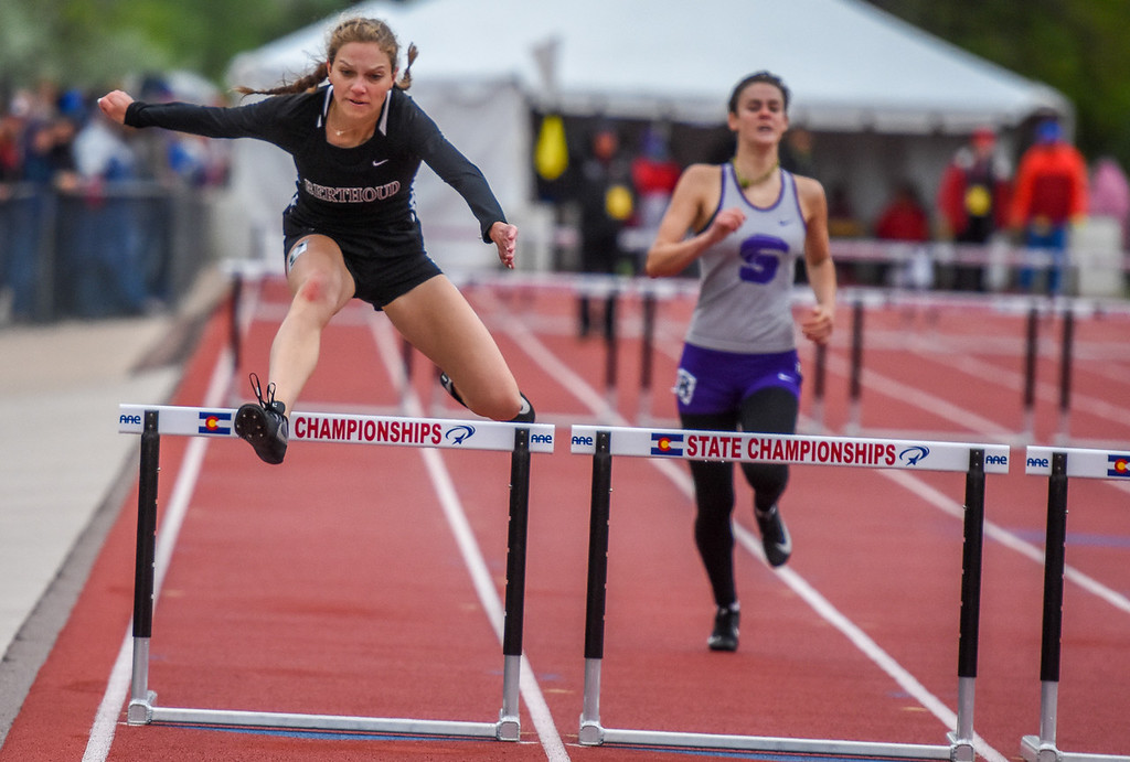 . Berthoud\'s Samantha Mulder leaps during the 3A 300-meter hurdles at the 2018 state track and field meet Saturday May 19, 2018 at Jeffco Stadium in Lakewood. (Cris Tiller / Loveland Reporter-Herald)