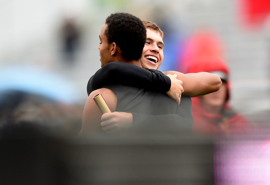 . Berthoud High School\'s Jake Rafferty hugs teammate Trinity Buckley after winning the 3A 4x100 final during the CHSAA State Track and Field Championships on Saturday at the Jeffco Stadium in Lakewood. For more photos of the races go to dailycamera.com Jeremy Papasso/ Staff Photographer 05/19/2018