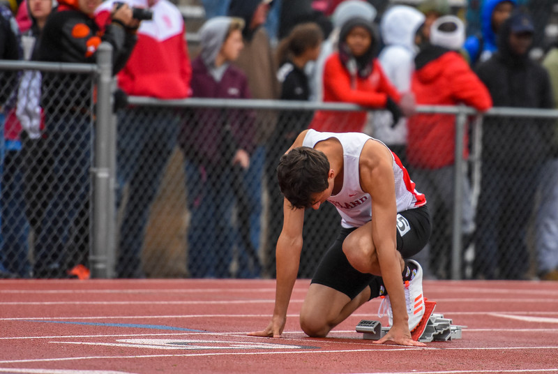 Loveland's Adam Stark settles into his blocks before the 5A 400-meter dash at the 2018 state track and field meet Saturday May 19, 2018 at Jeffco Stadium in Lakewood. (Cris Tiller / Loveland Reporter-Herald)