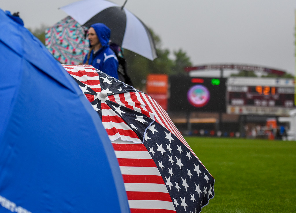 . Competitor hide under tents as the rains pours down at the 2018 state track and field meet Saturday May 19, 2018 at Jeffco Stadium in Lakewood. (Cris Tiller / Loveland Reporter-Herald)