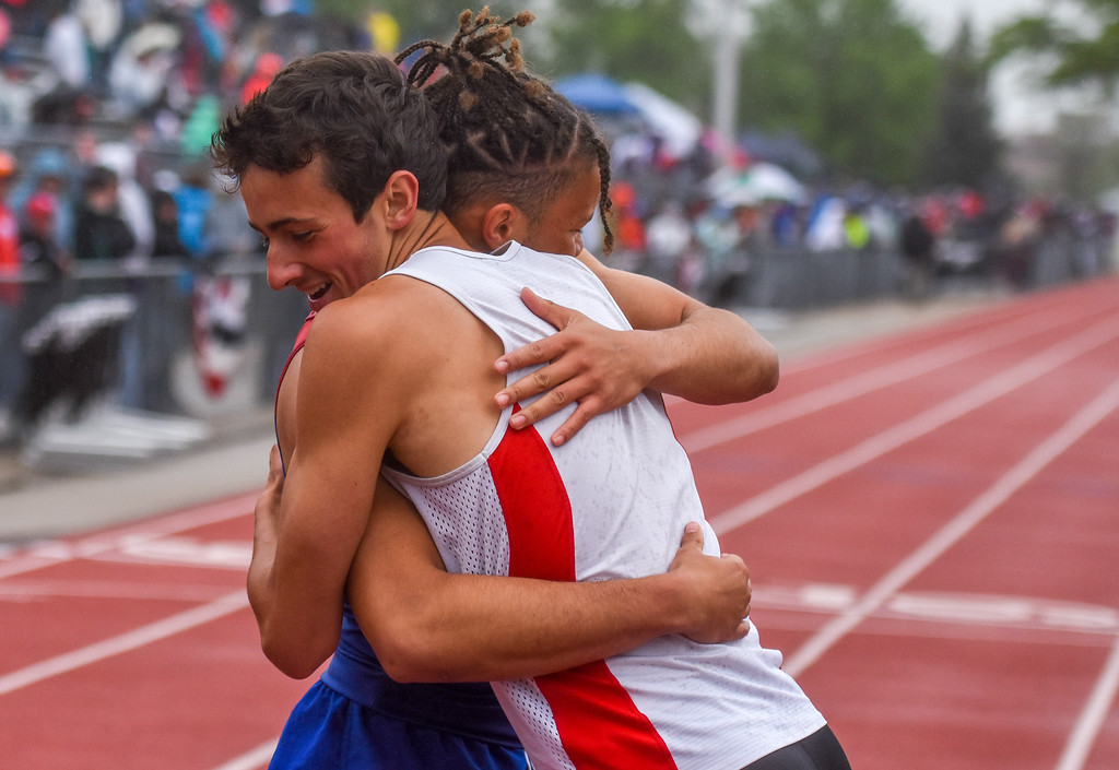 . Loveland\'s Adam Stark hugs 5A 400-meter dash champion Jalen Lyon, his future teammate at the University of Northern Colorado , at the 2018 state track and field meet Saturday May 19, 2018 at Jeffco Stadium in Lakewood. (Cris Tiller / Loveland Reporter-Herald)
