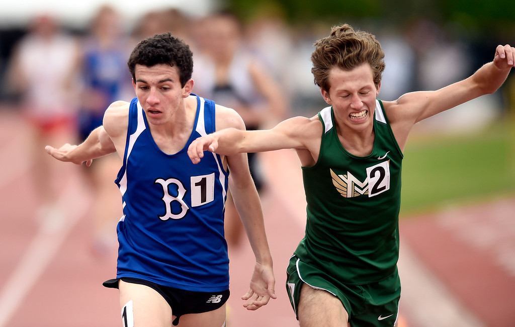 . Broomfield High School\'s Michael Mooney narrowly passes Carter Dillon to clench the 5A 1600-meter title during the CHSAA State Track and Field Championships on Saturday at the Jeffco Stadium in Lakewood. For more photos of the races go to dailycamera.com Jeremy Papasso/ Staff Photographer 05/19/2018