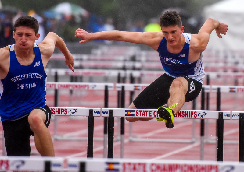 Resurrection Christian's Ben Jackson, left, and teammate Ryan Applebee race the 2A 110-meter hurdles at the 2018 state track and field meet Saturday May 19, 2018 at Jeffco Stadium in Lakewood. (Cris Tiller / Loveland Reporter-Herald)