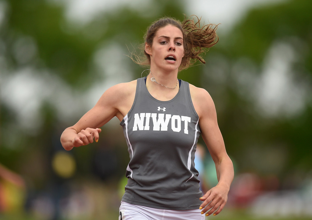 . Niwot High School\'s MacKenzie Fidelak finishes in 4rd place in the 4A 300-meter final during the CHSAA State Track and Field Championships on Saturday at the Jeffco Stadium in Lakewood. For more photos of the races go to dailycamera.com Jeremy Papasso/ Staff Photographer 05/19/2018