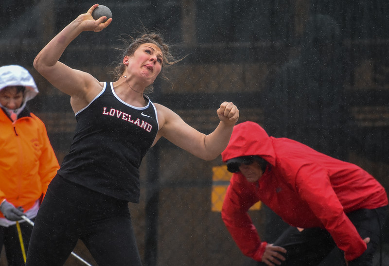 Loveland's Moira Dillow throws her shot through the rain at the 2018 state track and field meet Saturday May 19, 2018 at Jeffco Stadium in Lakewood. (Cris Tiller / Loveland Reporter-Herald)