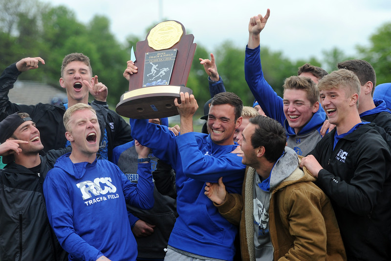 Resurrection Christian celebrates its 2A boys state track and field championship on Saturday at Jeffco Stadium. (Sean Star/Loveland Reporter-Herald)