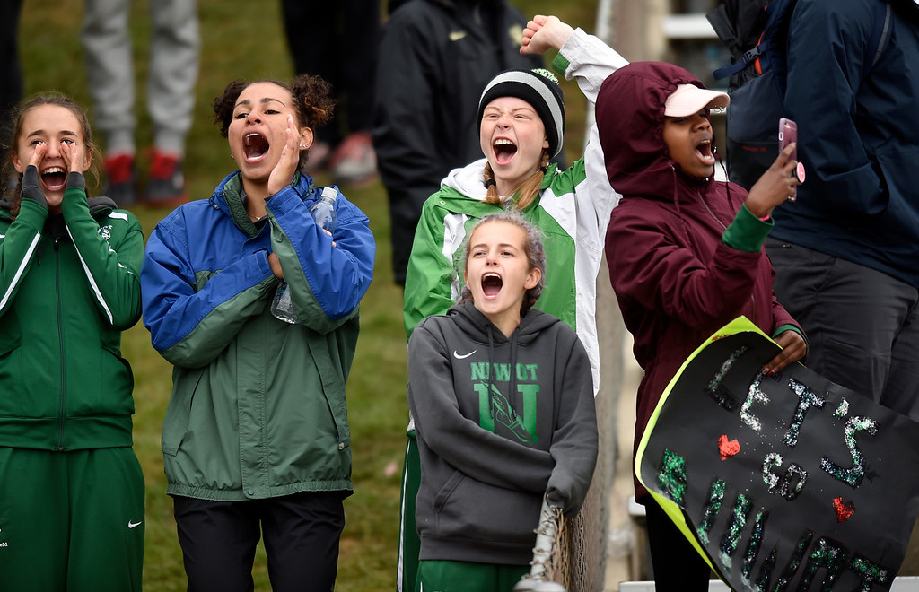 . Niwot High School track members cheer on a teammate in a race during the CHSAA State Track and Field Championships on Saturday at the Jeffco Stadium in Lakewood. For more photos of the races go to dailycamera.com Jeremy Papasso/ Staff Photographer 05/19/2018