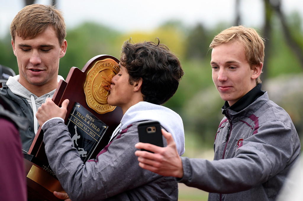 . Silver Creek High School\'s Henry Terhaar kisses the team championship trophy during the CHSAA State Track and Field Championships on Saturday at the Jeffco Stadium in Lakewood. For more photos of the races go to dailycamera.com Jeremy Papasso/ Staff Photographer 05/19/2018