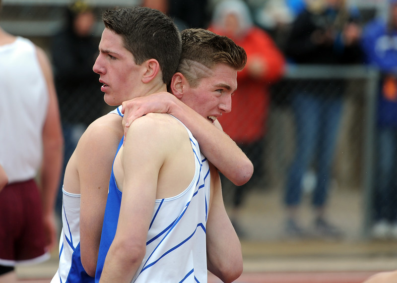 Resurrection Christian brother Preston, left, and Christian Fagerlin embrace after the 2A boys 1,600-meter run at the state track and field championships on Saturday, May 19, 2018 at Jeffco Stadium in Lakewood. (Sean Star/Loveland Reporter-Herald)