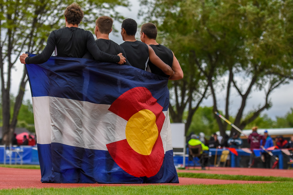 . Berthoud\'s 4x100-meter relay state championship team pose for a photo with the Colorado flag at the 2018 state track and field meet Saturday May 19, 2018 at Jeffco Stadium in Lakewood. (Cris Tiller / Loveland Reporter-Herald)