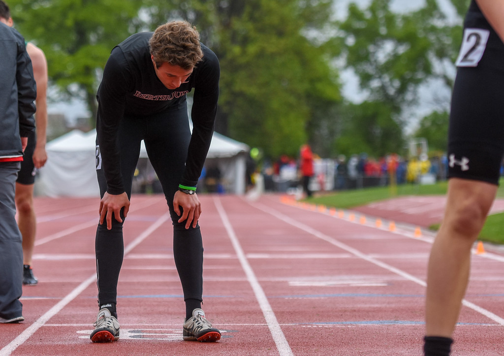 . Berthoud\'s Ryan Schmad takes a deep breath after finishing the 3A 400-meter dash at the 2018 state track and field meet Saturday May 19, 2018 at Jeffco Stadium in Lakewood. (Cris Tiller / Loveland Reporter-Herald)
