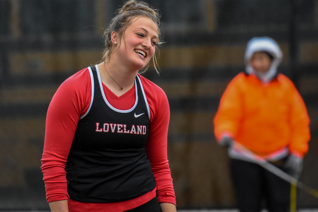 . Loveland\'s Moira Dillow laughs off a scratch at the 2018 state track and field meet Saturday May 19, 2018 at Jeffco Stadium in Lakewood. (Cris Tiller / Loveland Reporter-Herald)