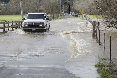 Shaun Walker — The Times-Standard  A pickup truck crosses a section of Berta Road flooded by the Elk River on Tuesday. More rain is expected for the rest of the week.