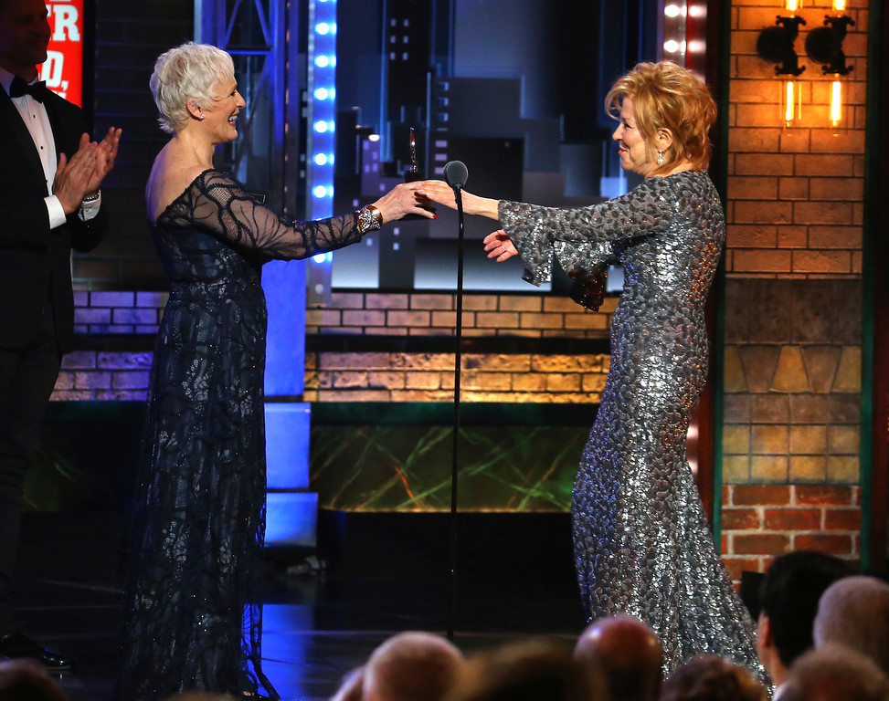 ". Glenn Close, left, presents the award for best performance by an actress in a leading role in a musical to Bette Midler for her role in ""Hello, Dolly!\"" at the 71st annual Tony Awards on Sunday, June 11, 2017, in New York. (Photo by Michael Zorn/Invision/AP)"