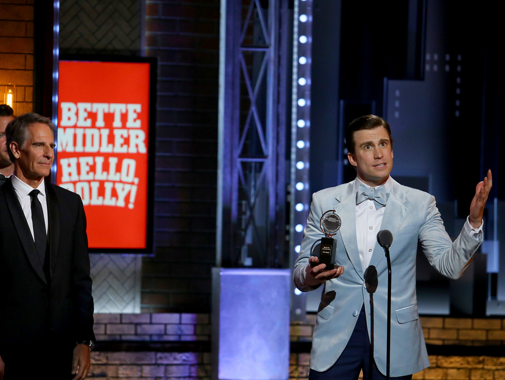 ". Gavin Creel, right, accepts the award for best performance by an actor in a featured role in a musical for ""Hello, Dolly!\"" at the 71st annual Tony Awards on Sunday, June 11, 2017, in New York. (Photo by Michael Zorn/Invision/AP)"