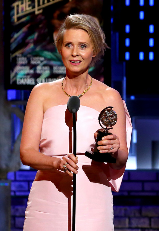 ". Cynthia Nixon accepts the award for best performance by an actress in a featured role in a play for ""Lillian Hellman\'s The Little Foxes\"" at the 71st annual Tony Awards on Sunday, June 11, 2017, in New York. (Photo by Michael Zorn/Invision/AP)"