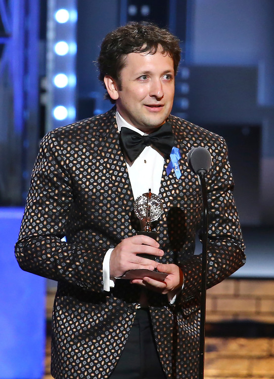 ". Bradley King accepts the award for best lighting design of a musical for ""Natasha, Pierre & The Great Comet of 1812\"" at the 71st annual Tony Awards on Sunday, June 11, 2017, in New York. (Photo by Michael Zorn/Invision/AP)"