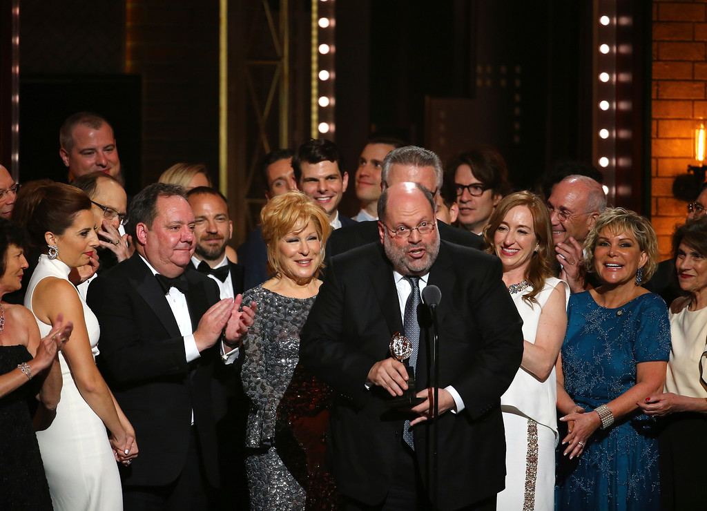 ". Scott Rudin, center, and the cast of ""Hello, Dolly!\"" accept the award for best revival of a musical at the 71st annual Tony Awards on Sunday, June 11, 2017, in New York. (Photo by Michael Zorn/Invision/AP)"