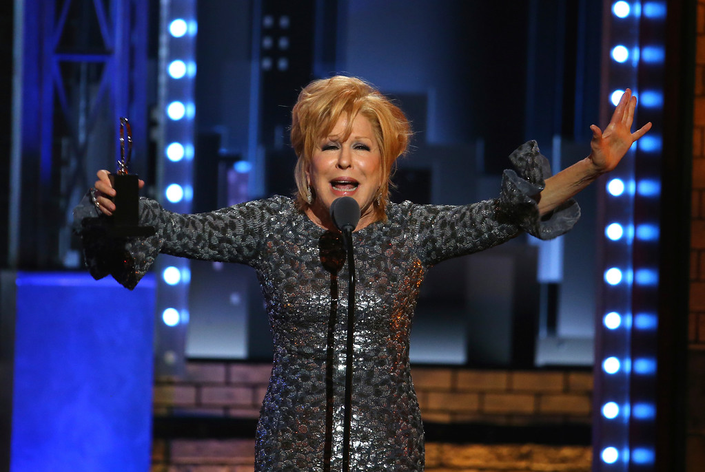 ". Bette Midler accepts the award for best performance by an actress in a leading role in a musical for ""Hello, Dolly!\"" at the 71st annual Tony Awards on Sunday, June 11, 2017, in New York. (Photo by Michael Zorn/Invision/AP)"