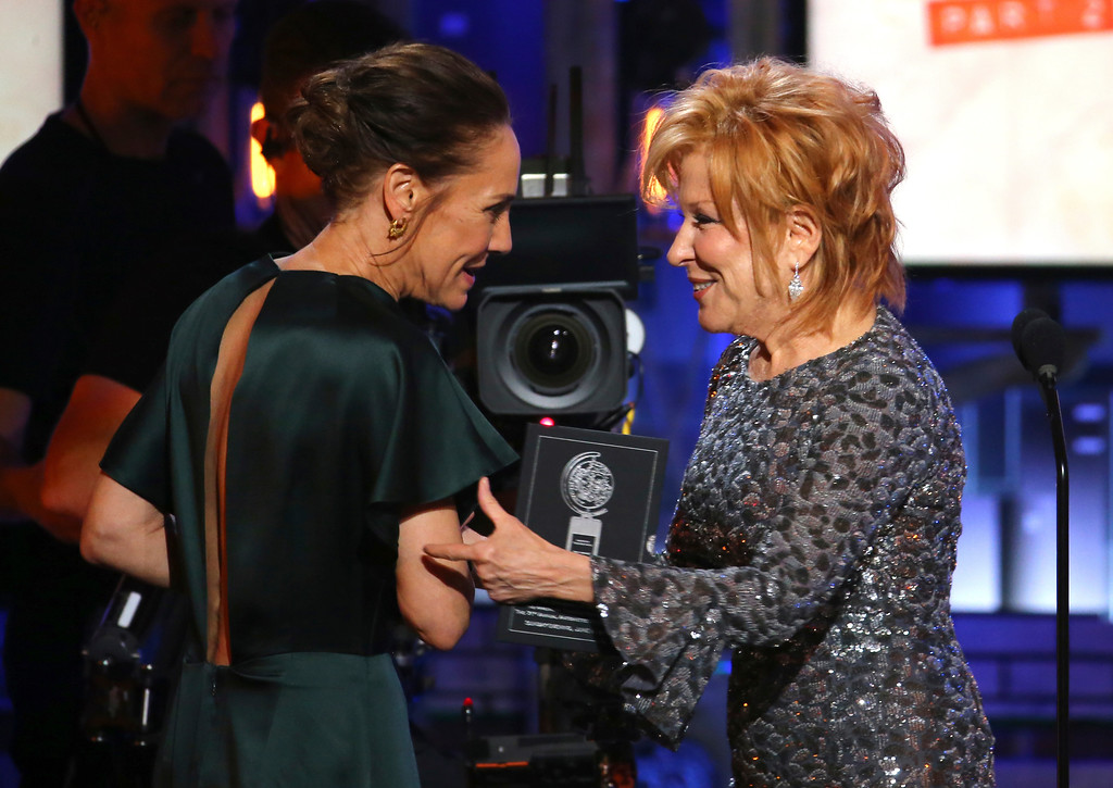 ". Bette Midler, right, presents the award for best performance by an actress in a leading role in a play to Laurie Metcalf for her roll in ""A Doll\'s House, Part 2\"" at the 71st annual Tony Awards on Sunday, June 11, 2017, in New York. (Photo by Michael Zorn/Invision/AP)"