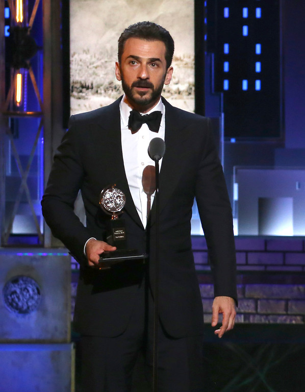 ". Michael Aronov accepts the award for best performance by an actor in a featured role in a play for ""Oslo\"" at the 71st annual Tony Awards on Sunday, June 11, 2017, in New York. (Photo by Michael Zorn/Invision/AP)"