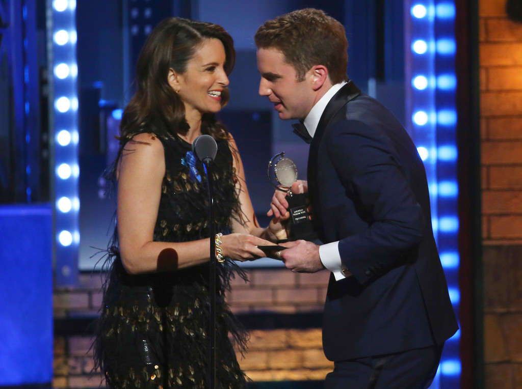 ". Tina Fey, left, presents the award for best performance by an actor in a leading role in a musical to Ben Platt for his role in ""Dear Evan Hansen\"" at the 71st annual Tony Awards on Sunday, June 11, 2017, in New York. (Photo by Michael Zorn/Invision/AP)"