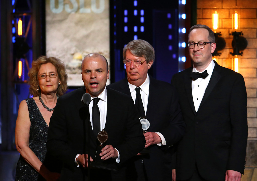 ". J.T. Rogers, foreground, and the cast and crew of ""Oslo\"" accept the award for best play at the 71st annual Tony Awards on Sunday, June 11, 2017, in New York. (Photo by Michael Zorn/Invision/AP)"