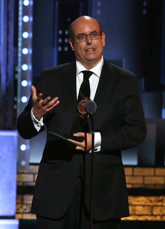 ". Christopher Ashley accepts the award for best direction of a musical for ""Come From Away\"" at the 71st annual Tony Awards on Sunday, June 11, 2017, in New York. (Photo by Michael Zorn/Invision/AP)"