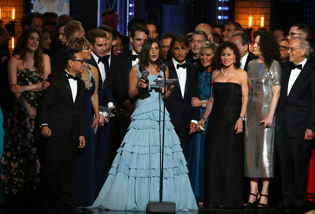 ". Wendy Orshan and the cast and crew of ""Dear Evan Hansen\"" accept the award for best musical at the 71st annual Tony Awards on Sunday, June 11, 2017, in New York. (Photo by Michael Zorn/Invision/AP)"