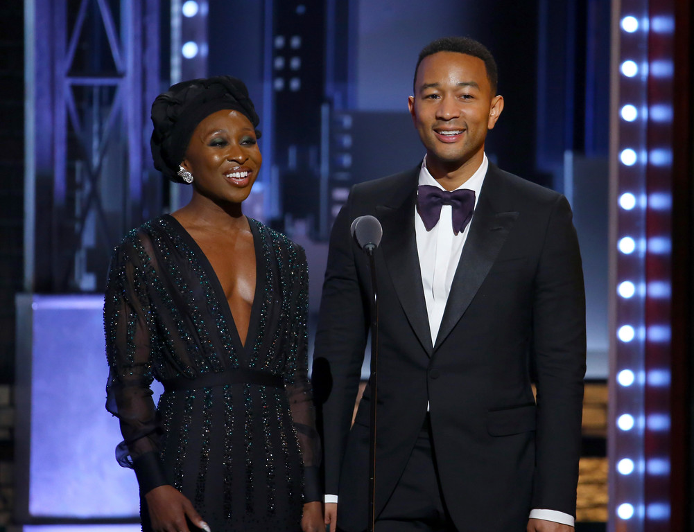 . Cynthia Erivo, left, and John Legend present the award for best original score (music and lyrics) written for the theatre at the 71st annual Tony Awards on Sunday, June 11, 2017, in New York. (Photo by Michael Zorn/Invision/AP)