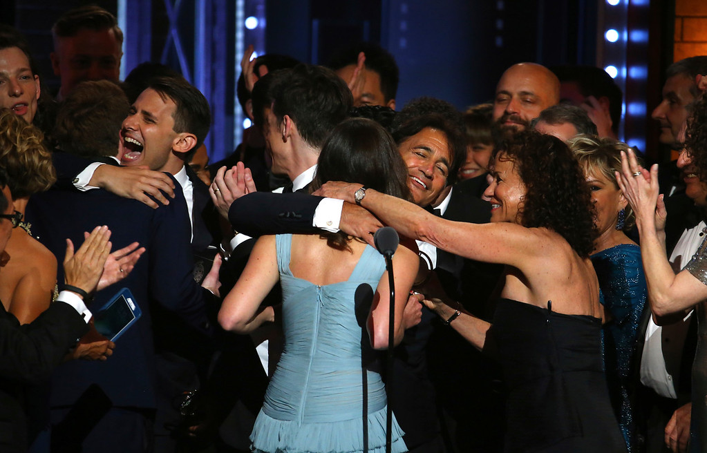". The cast and crew of ""Dear Evan Hansen\"" celebrate winning the award for best musical at the 71st annual Tony Awards on Sunday, June 11, 2017, in New York. (Photo by Michael Zorn/Invision/AP)"