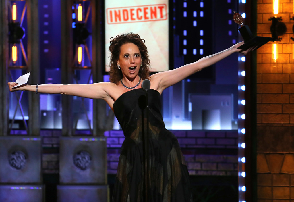 ". Rebecca Taichman accepts the award for best direction of a play for ""Indecent\"" at the 71st annual Tony Awards on Sunday, June 11, 2017, in New York. (Photo by Michael Zorn/Invision/AP)"