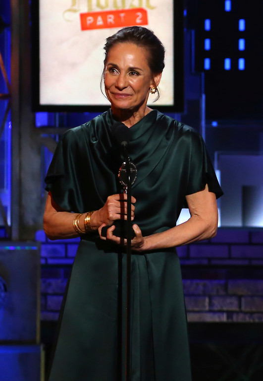 ". Laurie Metcalf accepts the award for best performance by an actress in a leading role in a play for ""A Doll\'s House, Part 2\"" at the 71st annual Tony Awards on Sunday, June 11, 2017, in New York. (Photo by Michael Zorn/Invision/AP)"