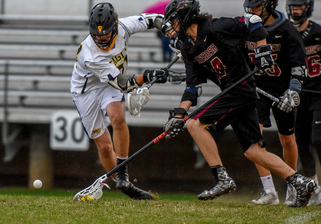 . Thompson Valley\'s Micah Payton battles for a ground ball against Ponderosa on Tuesday May 1, 2018 at Patterson Stadium. (Cris Tiller / Loveland Reporter-Herald)